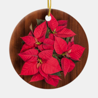 Red Christmas flower on brown wood Round Ceramic Decoration