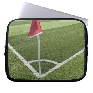 Red corner flag on soccer field laptop sleeve