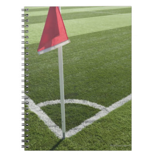 Red corner flag on soccer field notebook