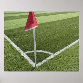 Red corner flag on soccer field poster