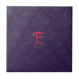 Red 'E' on purple embossed effect 3D fractal. Tile