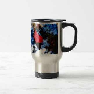 Red floating fall leaf with reflection of blue sky stainless steel travel mug