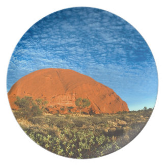 Red Glow of the Famous Ayers Rock in the Outback Plate