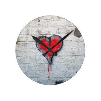 Red graffiti heart clocks