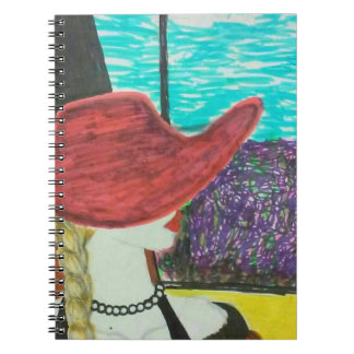 Red hat model traveling by train notebook
