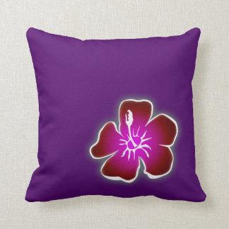 Red Hawaiian Hibiscus Flower on Purple Pillow