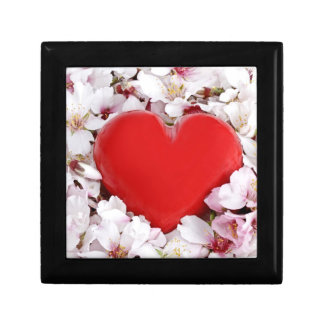 Red heart in a bed of flowers gift box
