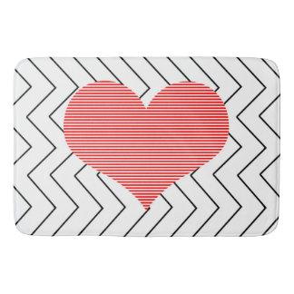 Red heart - Zigzag geometric pattern - black. Bath Mat