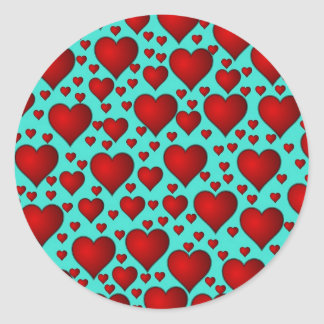 Red Hearts on Blue Background Classic Round Sticker