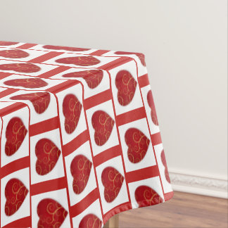 Red hearts on white Xmas tablecloth. Tablecloth
