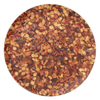 Red hot dried chilli flakes plate