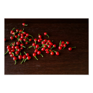Red hot peppers on dark wood poster