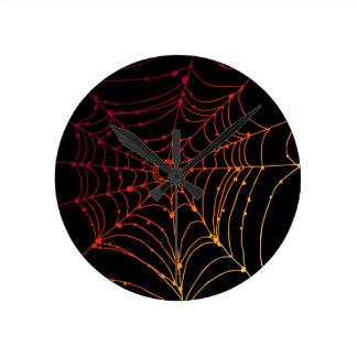 Red-ish gradient spider web round clock
