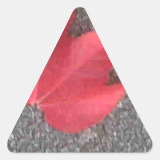 Red leaf on tarmac triangle sticker