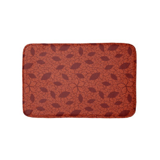 Red leaves pattern on orange bath mat