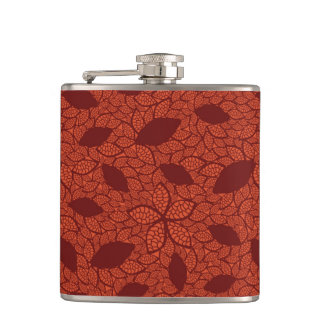 Red leaves pattern on orange flask