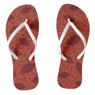 Red leaves pattern on orange flip flops