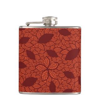 Red leaves pattern on orange hip flask