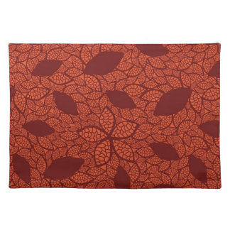 Red leaves pattern on orange placemat