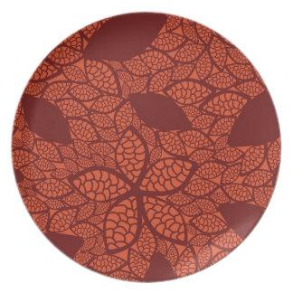 Red leaves pattern on orange plate
