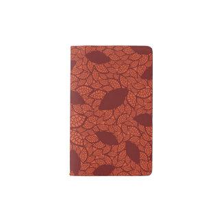 Red leaves pattern on orange pocket moleskine notebook