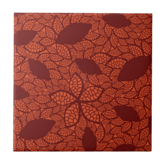Red leaves pattern on orange tile