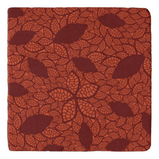 Red leaves pattern on orange trivet