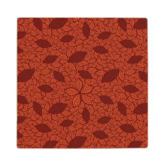 Red leaves pattern on orange wood coaster