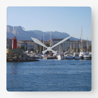 Red light and sailboats in the port clocks