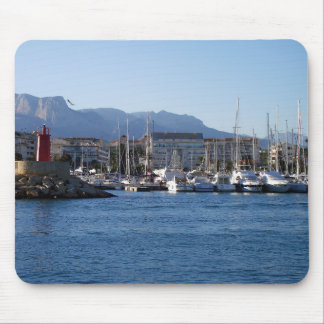 Red light and sailboats in the port mouse mat