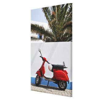 Red motor scooter by wall, Stromboli Island, Canvas Print