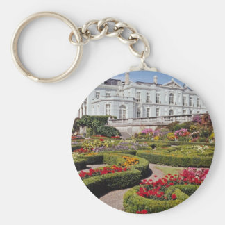 Red Oldway mansion, Paignton, Devon, England flowe Basic Round Button Key Ring