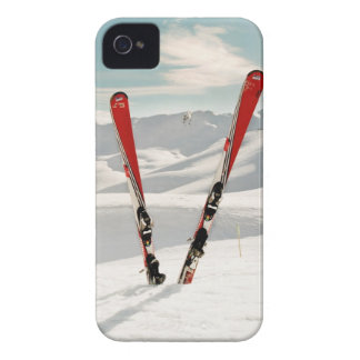 Red pair of ski standing in snow iPhone 4 covers