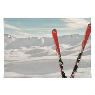 Red pair of ski standing in snow place mat
