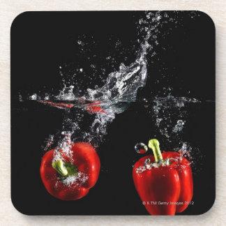 red pepper splashing in water coaster