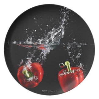 red pepper splashing in water plate