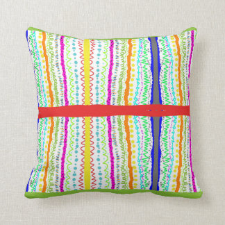 red pillow with a colorfull pattern