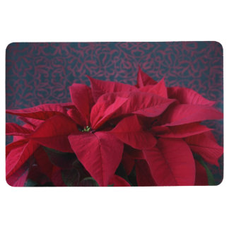 Red poinsettias on decorative background floor mat