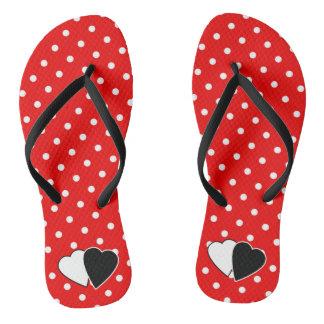 Red polka dot flip flops