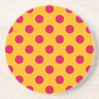Red polka dots on yellow drink coaster