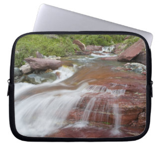 Red rock in Baring Creek in Glacier National Laptop Sleeve
