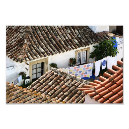 Red roofs and hanging clothes in mediterranean art photo