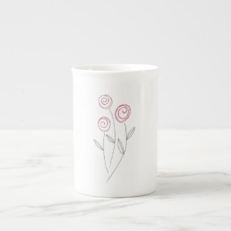 red rose buds tea cup