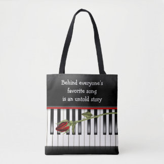 red rose on piano keyboard tote bag