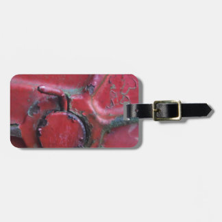 Red rusty truck close-up luggage tag