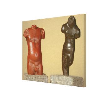 Red sandstone male torso and grey sandstone dancer canvas print