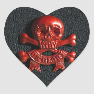 Red scull and cross bones heart sticker