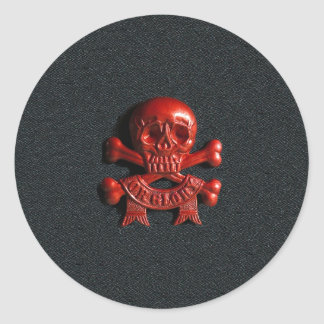 Red scull and cross bones round sticker