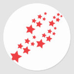 red stars falling classic round sticker