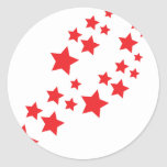 red stars falling classic round sticker